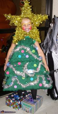 Stacy: This is my 8 year old daughter wearing the bright light up Christmas tree this year. We started with cardboard cut into triangles, there were 4 for each