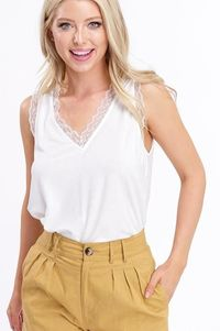 LASTING WHITE JERSEY TOP $25.00