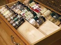Spice organizer for the drawer - how great to see what you have without spinning a rack or rummaging through the cupboards. Now how am I going to clear out a drawer to add this?