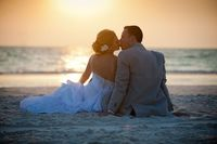 Don't want to do a trash the dress wedding but maybe sit in the sand like this, on a beach towel of course!
