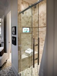 Browse master bathroom pictures from HGTV Smart Home 2014. Sophisticated and serene, the master bathroom shines with chrome hardware, a latte color scheme and a