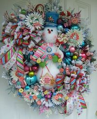 smowman wreath...very festive love the colors...snowman is styrofoam balls. starting a new board...things to do in the fall