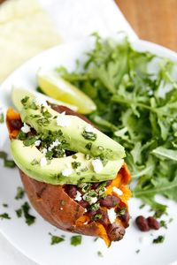 Baked Sweet Potato -- these loaded baked sweet potatoes, topped with honey-lime chipotle black beans, sliced avocado, crumbled queso fresco, and chopped fresh cilantro, are a fantastic meatless meal solution! One of our fave Lent recipes... | via