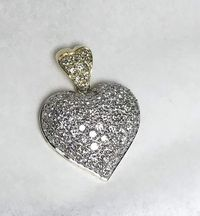 Diamond heart pendent 2,20 carats of natural diamonds in 14 karats two tones white and yellow Gold $1200.00