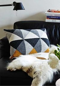Tunesian crochet pillow with triangles