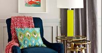 Love the navy couch paired with The yellow lamp