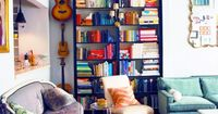 Ikea Billy Bookshelves painted with molding added at the top to look like casework