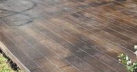scored and stained concrete to look like wood floors on the patio. awesome idea