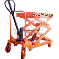 Hydraulic Scissor lifting tables are platforms with a scissor mechanism for lifting and lowering materials at various, ergonomically optimum height, for specific application or process. Read more: http://www.bobengineering.co.in/hydraulic-scissor-lift.htm...