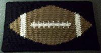 Free crochet pattern for a tapestry crochet football mat.