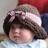Use left over yarn from Jordy's carrier blanket to match. Baby's Winter Cloche Cute hat .... cuter baby!