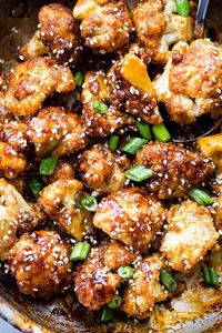 "Sticky Sesame Cauliflower Bites �€"" Sweet, spicy, baked cauliflower bites topped with an amazing Asian-inspired sticky sauce!"