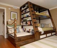 Awesome use of space! » It really is! I think I would add shelves/storage under the reading nook. Neatly Nautical.