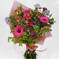 Bouquet of spring / summer flowers. Germini Pink, purple lilac, sweet peas, alchemilla pink astrantia.