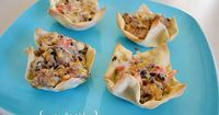 Sausage Wontons (sausage, shredded cheese cheddar, shredded cheese monteray jack, ranch dressing, olives, red bell pepper, won ton wrappers)