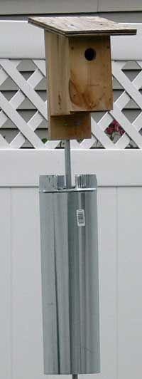 Wobbling stovepipe baffle or predator guard. See one that uses a bucket