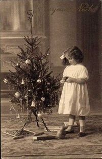 Why not make sweet Christmas cards tags this year by copying your vintage family photos.