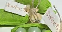 Pea pod baby shower favors... using green sixlets candies and green crepe paper streamers.