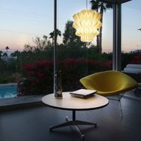 Hanging in a home in Palm Springs is the LUUM Pendant Lamp by SplinterSeed.