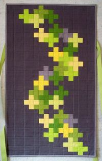 Esch House quilts. This is a modern take on a crosses quilt pattern. I love the style.