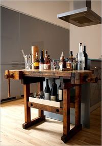 Great use for an old work bench; many stories were made upon those pieces of wood.
