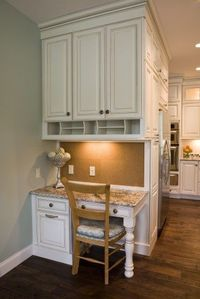 """Country Cottage Style Home �€"""" Custom designed desk area with under cabinet lighting, cork board and letter divider"""