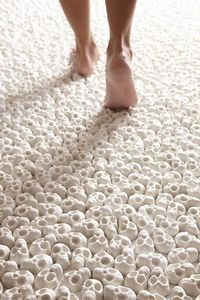 In this thought-provoking exhibit, visitors were invited to walk along the surface of 100,000 miniature porcelain skulls. The project, entitled What Will You Le