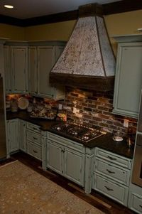 Cool Kitchen...great cabinets and exposed brick backsplash!