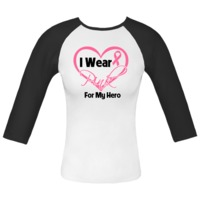 I Wear Pink For My Hero Breast Cancer awareness Fitted Raglan T-Shirts featuring a heart design with a pink ribbon to signify support, hope and awareness by BreastCancerApparel.Net.