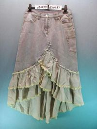 Jean skirt with ruffles. This works well as steampunk because it is not a blue denim, so it looks less like the typical denim skirt. Use bleach and/or dye if all you have is blue denim. Great way to give new life to jeans that fit well but have large hole...