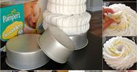 Diaper Cake Tutorial. I've made diaper cakes, but never thought to use cake pans! It would make it so much easier to hold all the diapers together for easier tying.