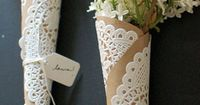 Doily flower wraps A perfect wedding place setting or just as a special gift, these doily flower wraps use these pretty doilies from Papermash, but any will work. Flower vials are easily found online.