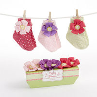 """Every girl deserves flowers scattered at her feet! Our """"Baby in Bloom"""" socks do exactly that, and the flowers follow her wherever she goes. You'll be starting her off on the right foot, fashion-wise!"""