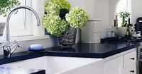 white cabinet with black counter tops