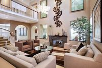 This is an open floor plan done right....I love the multiple seating areas, and how the small fireplace anchors the room.