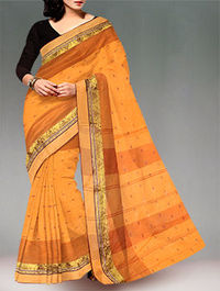 Shop online exclusive pure handloom dhaka cotton tant saree at unnatisilks.com Peach orange and brown color pure handloom Dhaka cotton tant saree without blouse.This cotton sari has got all over thread weaving bootis along with brown thread woven temple ...
