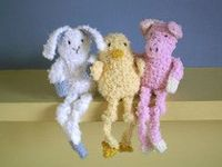 These little creatures have bean bag bodies to help them sit up and long dangly legs. They are about 10cm tall (not counting their legs) and instructions are included for knitting a duckling, a pig and a bunny.