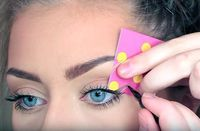 We love this trick! Cut out your desired cat-eye shape from an old greeting card. Then hold it against your eye and color it in. That's it...