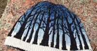...Frostfangs Hat by Liz Smith... Clever use of a shaded blue.