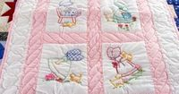 Handmade Amish Baby Quilt - embroidered Sun Bonnet Sue pattern.