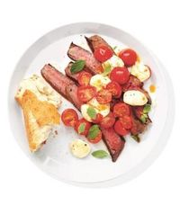 """Beef up a classic caprese salad�€""""literally�€""""with seared sirloin to make a complete meal. Get the recipe for Steak With Mozzarella and Tomatoes."""