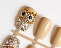 Glam Owls - 12 glamorous nude/beige owl nails with gold,silver and black rhinestones. �'�28,00, via Etsy.