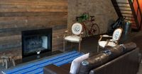Erie Loft in Chicago featuring upcycled reclaimed wood fireplace, original timber beams and masonry walls.