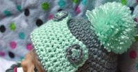 Baby Button Eskimo Hat - This cozy hat is a cute and fun baby accessory for winter! {Free pattern by Whistle and ivy}