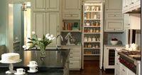 love this concealed pantry. Have been trying to figure out how to put mine behind a wall and keep the kitchen flow. I like this.