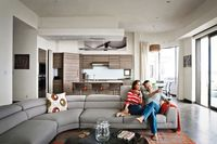 Actor Bryan Cranston and his wife rescued a decaying piece of military housing and gave it a modern makeover, throwing splashes of warm color onto neutral canvas of plush furniture for a beach house as snug as it is sleek. Photo by Art Streiber.