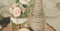 Vintage Burlap Centerpiece. Love the three different heights. Maybe a twine covered bottle (with actual sparkling cider for the toast!) mason jar full of white and creamy flowers and instead of a table number, a vintage looking frame big enough fo...