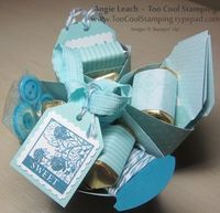 Donna Griffith shared a project using the Diagonal Plate for Simply Scored; Look at all the fun stuff this blogger stuck inside! 8 Wrapped Hershey's Nuggets 3 Pretty Postage Gift Tags 5 Tempting Turquoise Bright Buttons 3 Heart Notes with Mini Envelop...