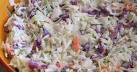 This recipe for creamy buttermilk coleslaw has a creamy buttermilk dressing. Delicious served with pulled pork.