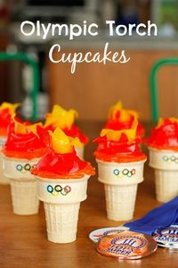 Olympic Torch Cupcakes -- if you've ever made ice cream cone cupcakes, these adorable Olympic torch cupcakes will be a cinch to make. Go USA!!! | via